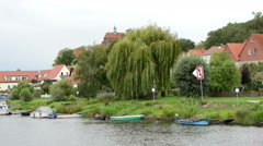 Driving with boat on Havel River. passing by historical cityscape of Havelberg w Stock Footage