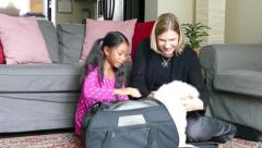 Cute Little Asian Girl Gets A New Puppy Stock Footage