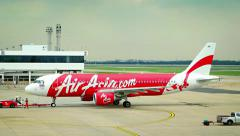 Commercial passenger AirAsia aircraft prepare for takeoff Stock Footage