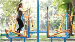 Portrait of thai adult beautiful girl doing exercises in the park Stock Footage