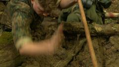 German soldiers digging foxhole pan right Stock Footage