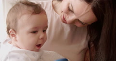 Mother And Baby Playing With Colorful Toy At Home - stock footage