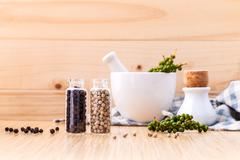 Assorted of spice bottles condiment black pepper ,white pepper and  green pep - stock photo