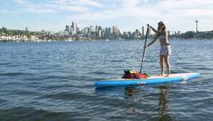 Seattle,WA -  Woman Paddle Boarding on Lake Union with Space Needl Stock Footage