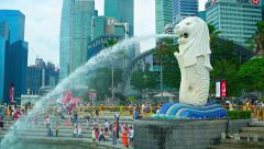 Merlion is Singapore icon and symbol in Marina Bay with modern skyscrapers Stock Footage