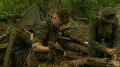 German soldiers digging foxhole pan Stock Footage