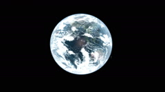 Scissors cut out a rotating earth against black, Green Screen transition. Stock Footage