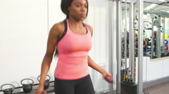 Young African American woman skipping at a gym Stock Footage
