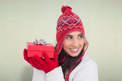 Composite image of happy brown hair holding red gift Stock Photos