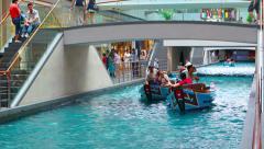 People enjoy Sampan ride on gondola boat at Shoppes at Marina Bay Sands Stock Footage