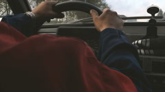 Man driving car close up back view Stock Footage