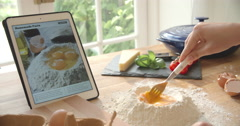 Person Following Pasta Recipe Using App On Digital Tablet - stock footage
