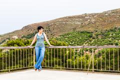 woman on the background of ancient town. Crete - stock photo