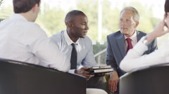 4k Confident male business group in negotiation meeting shake hands on a deal. - stock footage