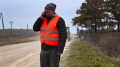 Engineer with smartphone in road repairs Stock Footage