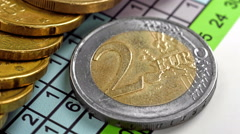 Two euro coins and business report Stock Footage