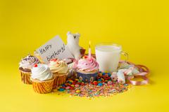 Fun kid birthday concept. Sweets and cupcakes - stock photo