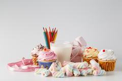 Heap of colored sweets on white background - stock photo