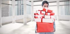 Stock Photo of Composite image of fired businesswoman holding box of belongings