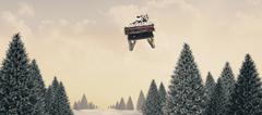 Stock Illustration of Composite image of santa flying his sleigh