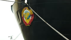 Soviet Hammer and Sickle emblem on bow of a ship in Russia Stock Footage