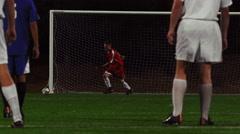 A goalkeeper kicks a soccer ball back into play - stock footage