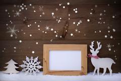 White Christmas Decoration On Snow, Copy Space, Sparkling Stars - stock photo