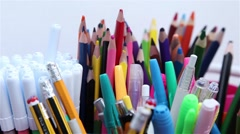 Several pens and colored pencils Stock Footage
