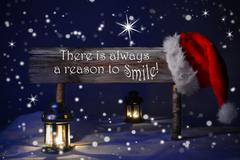 Christmas Sign Candlelight Santa Hat Always Reason Smile - stock photo