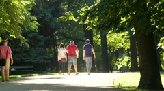 Tourists walking on an alley in a park, Warsaw Stock Footage