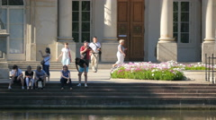 Walking and sitting on the stairs in front of Palace on the Water, Warsaw Stock Footage