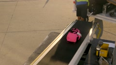 Person loading baggage onto plane, 4K Stock Footage