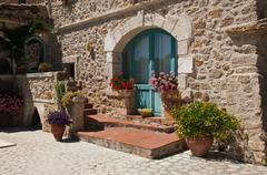 traditional méditeranean property with flowers - stock photo