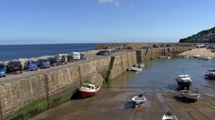 Mousehole Cornwall fishing boats pan Stock Footage