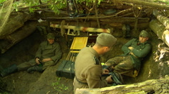 German soldiers relaxing in foxhole Stock Footage