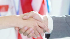 4K Close up on hands of diplomats in office shaking hands on a deal Stock Footage