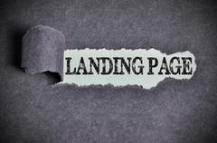 landing page word under torn black sugar paper - stock photo