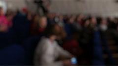 Stock Video Footage of Anonymous Audience in Theatre Auditorium Defocused, Steadycam Sliding Shot