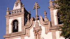 Cross and bell of an old church Stock Footage