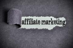 Stock Photo of affiliate marketing word under torn black sugar paper