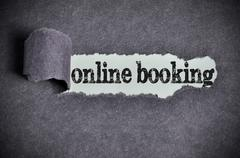 Online booking word under torn black sugar paper Stock Photos