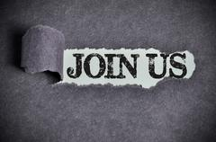 Join us word under torn black sugar paper Stock Photos