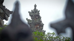 Slow motion tilt and pan of a Balinese Temple seen through gate Stock Footage