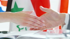 4K Close up on hands of diplomats in office shaking hands on a deal - stock footage