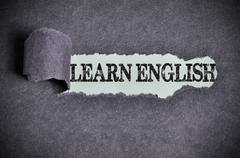 Learn english word under torn black sugar paper Stock Photos
