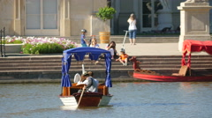 Blue boat with tourists heading to Palace on the Water in Warsaw Stock Footage