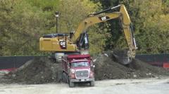 Excavator Loading Soil on a Dump Truck Stock Footage