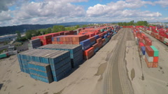 An aerial over a rail freight yard with containers in transit. Stock Footage