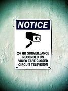 Surveillance Sign on Concrete Wall Stock Photos