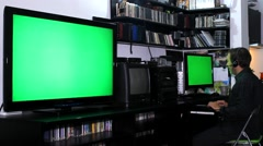 Man work on computer at home and chat,green screen  - stock footage
